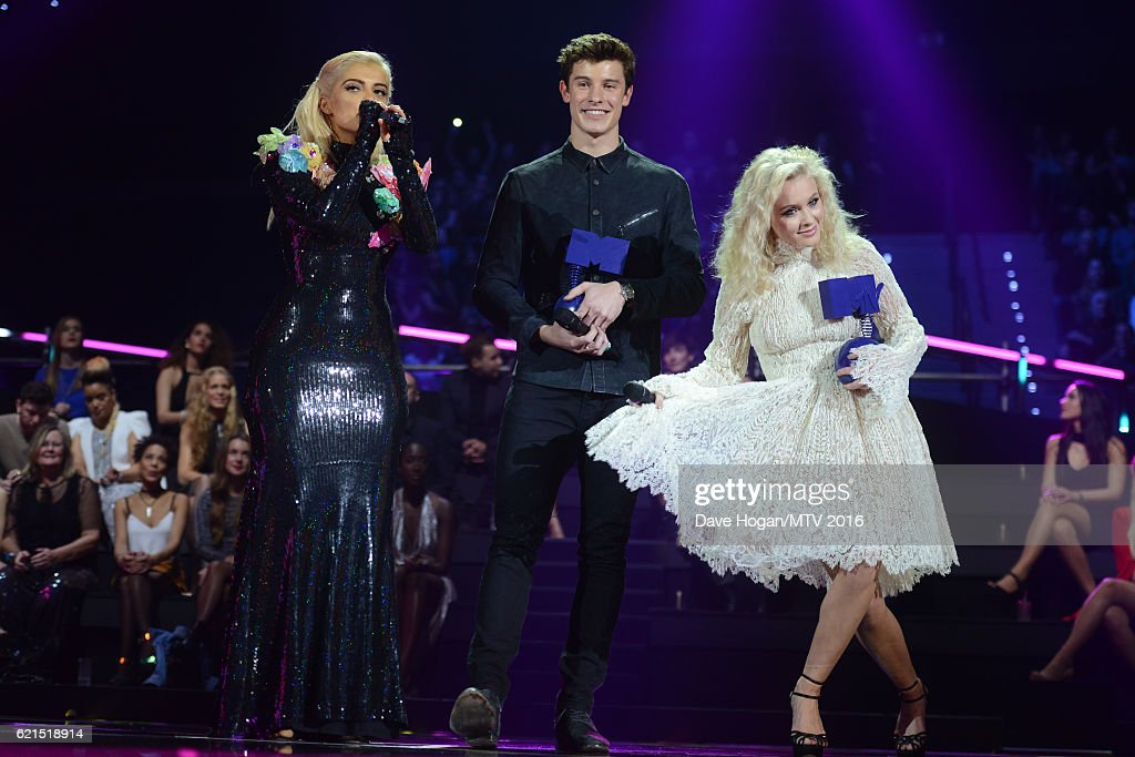 Host Bebe Rexha and Winners of Woldwide Act award Shawn Mendes and Zara Larsson with their awards on stage during the MTV Europe Music Awards 2016 on November 6, 2016 in Rotterdam, Netherlands.