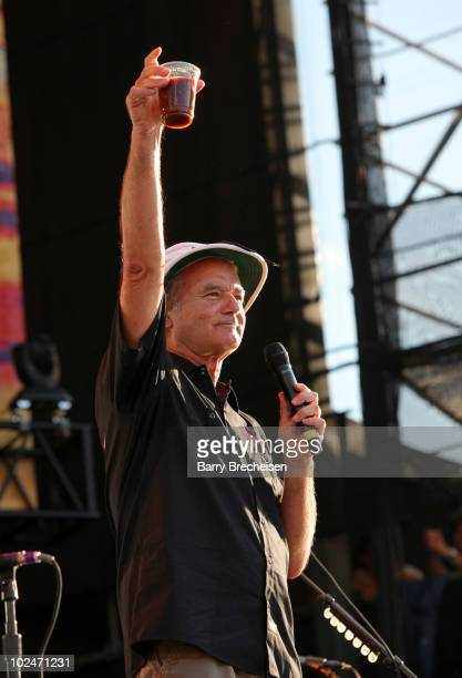Host Bill Murray raffling off Gregg Allman's live in cup as he performs onstage during the 2010 Crossroads Guitar Festival at Toyota Park on June 26...