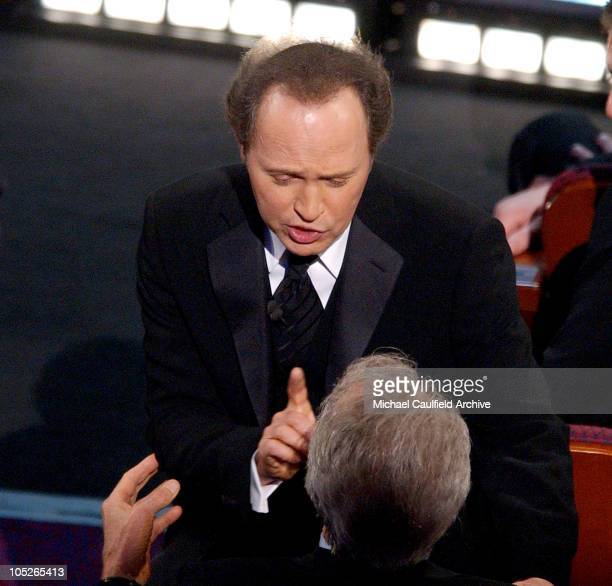 Host Billy Crystal and Clint Eastwood during The 76th Annual Academy Awards Show at The Kodak Theater in Hollywood California United States