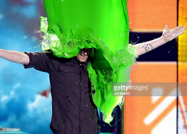 Host Blake Shelton gets slimed onstage during Nickelodeon's 2016 Kids' Choice Awards at The Forum on March 12, 2016 in Inglewood, California.