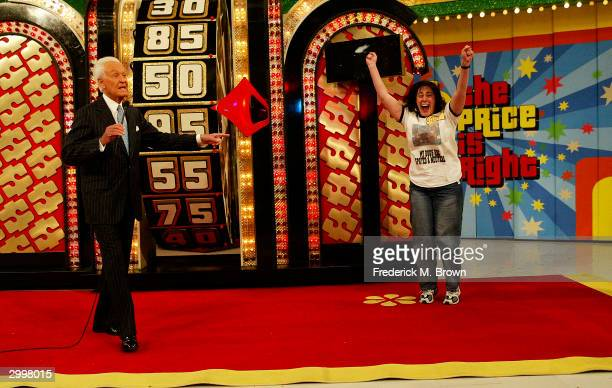 Host Bob Barker and a show contestant celebrate during the 6000th taping of 'The Price Is Right' television show on February 19 2004 at CBS...
