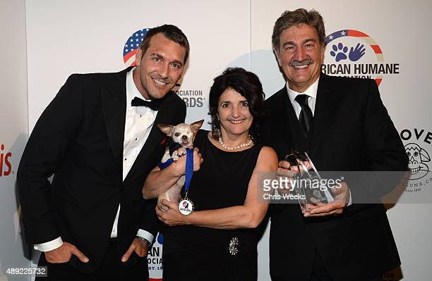 TV host Brandon McMillan Harley Emerging Hero Dogs Category Winner and guest pose backstage at the American Humane Association's 5th Annual Hero Dog...