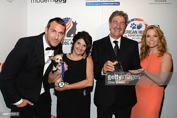 TV host Brandon McMillan Harley Emerging Hero Dogs Category Winner Rudi Taylor guest and Actress Lea Thompson pose backstage at the American Humane...