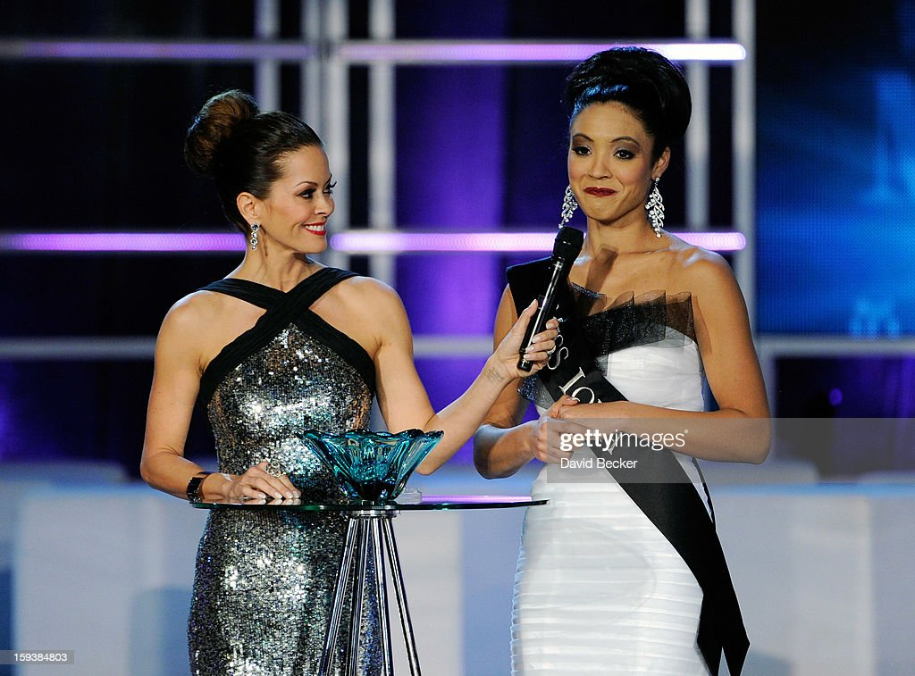 Host Brooke Burke Charvet (L) holds a microphone for Mariah Cary, Miss Iowa, as she answers a question during the interview portion at the 2013 Miss America Pageant at PH Live at Planet Hollywood Resort & Casino on January 12, 2013 in Las Vegas, Nevada.