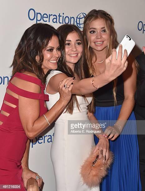 TV host Brooke BurkeCharvet Sierra Sky Fisher and Neriah Shae Fisher attend Operation Smile's 2015 Smile Gala at the Beverly Wilshire Four Seasons...