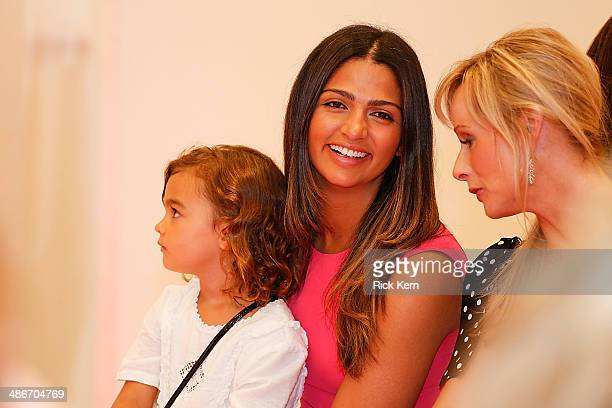 Host Camila Alves McConaughey and her daughter Vida McConaughey watch the Badgley Mischka Fashion Event at Neiman Marcus on April 25 2014 in Austin...