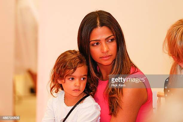 Host Camila Alves McConaughey and her daughter Vida McConaughey watch the Badgley Mischka Fashion Event at Neiman Marcus on April 25, 2014 in Austin,...