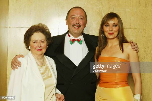 Host Carol Vorderman poses for photographers with her mother and brother, Anton, at the 'Cleft Lip and Palate Association' Grand Jubilee Ball to...
