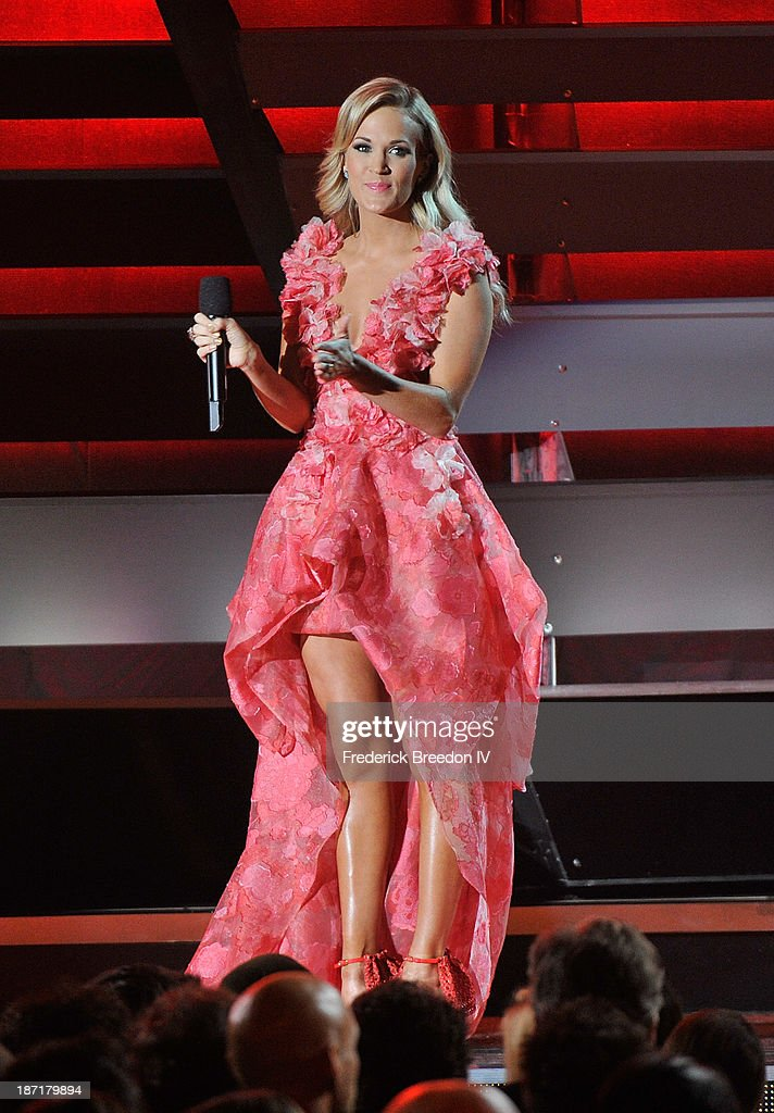 Host Carrie Underwood on stage during the 47th annual CMA awards at the Bridgestone Arena on November 6, 2013 in Nashville, Tennessee.