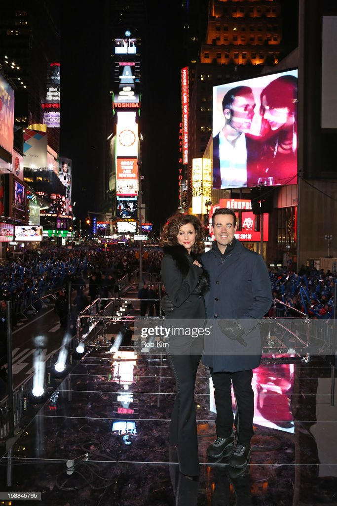Host Carson Daly (R) and Bridget Moynahan attend New Year's Eve 2013 With Carson Daly in Times Square on December 31, 2012 in New York City.