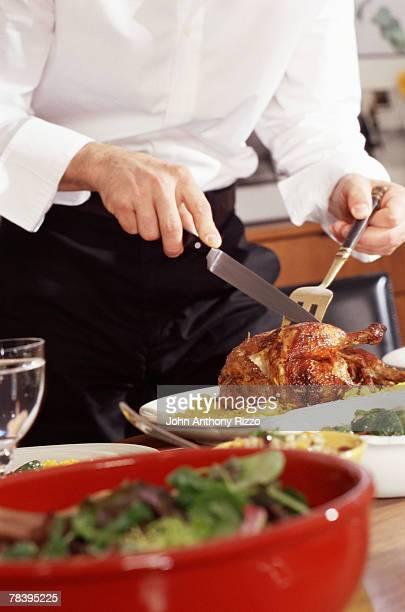 Host carving roast cornish hen