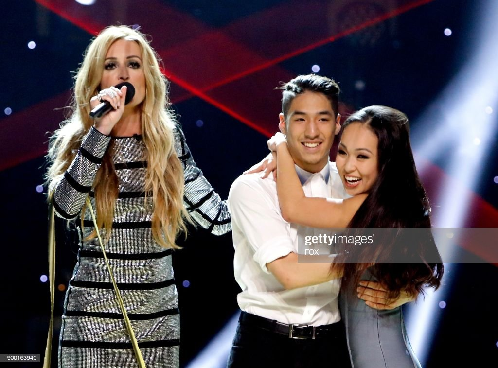 Host Cat Deeley (L) announces Lex Ishimoto (C) Americas favorite dancer with runner-up Koine Iwasaki on the Season Finale of SO YOU THINK YOU CAN DANCE airing Monday, September 25 (8:00-10:00 PM ET live/PT tape-delayed) on FOX.