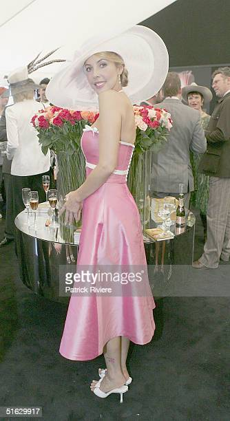 TV host Catriona Rowntree attends the Melbourne Cup Carnival's Derby Day in the Moet et Chandon marquee at Flemington October 30 2004 in Sydney...