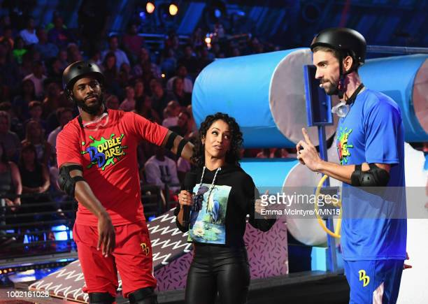 Host Chris Paul Liza Koshy and Michael Phelps participate in a challenge during the Nickelodeon Kids' Choice Sports 2018 at Barker Hangar on July 19...