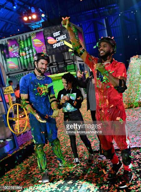 Host Chris Paul Liza Koshy Marc Summers and Michael Phelps participate in a challenge during the Nickelodeon Kids' Choice Sports 2018 at Barker...