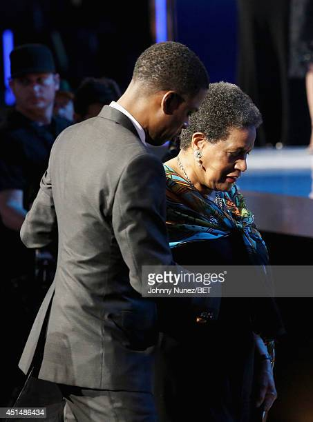 Host Chris Rock and Humanitarian Award Winner and civil rights activist Myrlie EversWilliams onstage during the BET AWARDS '14 at Nokia Theatre LA...