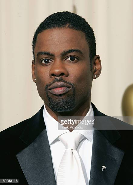 Host Chris Rock poses backstage during the 77th Annual Academy Awards on February 27 2005 at the Kodak Theater in Hollywood California
