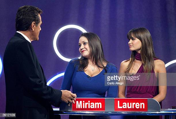 """Host Chuck Woolery talks to Miriam and Lauren, Playboy Playmates who were contestants on the gameshow """"Lingo"""" October 17, 2003 in Los Angeles,..."""