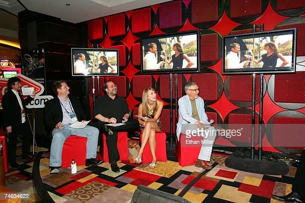 Host CineVegas associate director of programming Mike Plante looks on as VP of Marketing for Vegascom Bryan Allison president of Vegascom Howard...