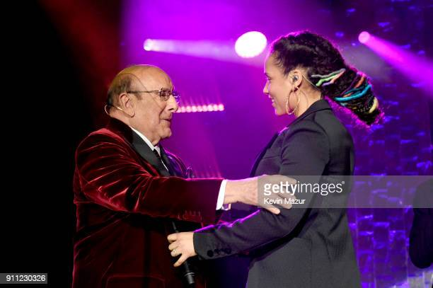 Host Clive Davis and recording artist Alicia Keys embrace onstage during the Clive Davis and Recording Academy PreGRAMMY Gala and GRAMMY Salute to...
