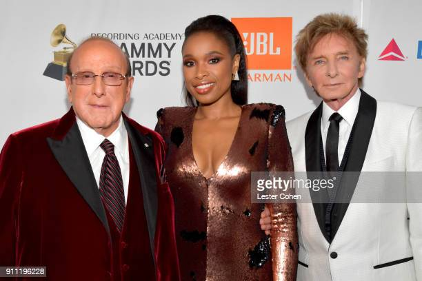 Host Clive Davis recording artist Jennifer Hudson and recording artist Barry Manilow attend the Clive Davis and Recording Academy PreGRAMMY Gala and...