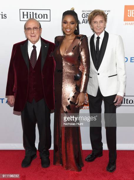 Host Clive Davis recording artists Jennifer Hudson and Barry Manilow attend the Clive Davis and Recording Academy PreGRAMMY Gala and GRAMMY Salute to...