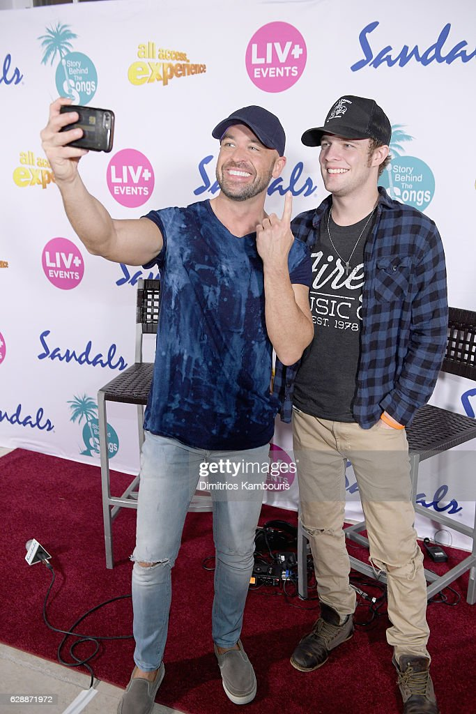 Host Cody Alan (L) and recording artist Tucker Beathard attend CMT Story Behind The Songs LIV + Weekend at Sandals Royal Bahamian Spa Resort & Offshore Island - Day 2 at Sandals Royal Bahamian on December 9, 2016 in Nassau, Bahamas.