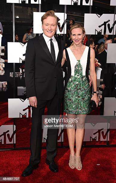 Host Conan O'Brien and Liza Powel attend the 2014 MTV Movie Awards at Nokia Theatre LA Live on April 13 2014 in Los Angeles California