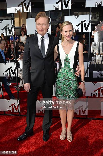 Host Conan O'Brien and Liza Powel attend the 2014 MTV Movie Awards at Nokia Theatre L.A. Live on April 13, 2014 in Los Angeles, California.