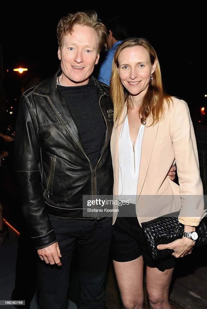 TV host Conan O'Brien (L) and Liza Powel OBrien attend Coach's 3rd Annual Evening of Cocktails and Shopping to Benefit the Children's Defense Fund hosted by Katie McGrath, J.J. Abrams and Bryan Burk at Bad Robot on April 10, 2013 in Santa Monica, California.
