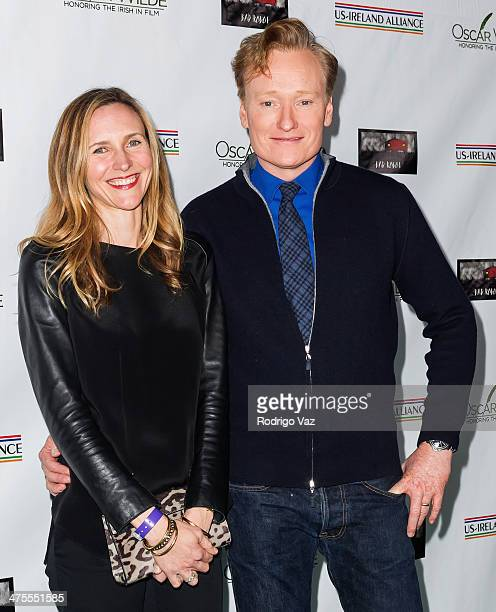 TV host Conan O'Brien and Liza Powell attend the USIreland Alliance PreAcademy Awards Event Honoring Conan O'Brien and Chad Hurley at Bad Robot on...