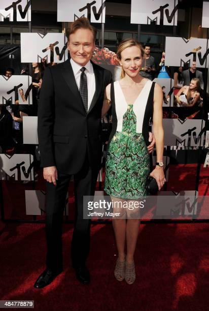 Host Conan O'Brien Liza Powel O'Brien attend the 2014 MTV Movie Awards at Nokia Theatre LA Live on April 13 2014 in Los Angeles California