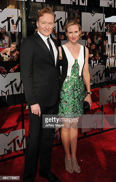 Host Conan O'Brien Liza Powel O'Brien attend the 2014 MTV Movie Awards at Nokia Theatre LA Live on April 13 2014 in Los Angeles California