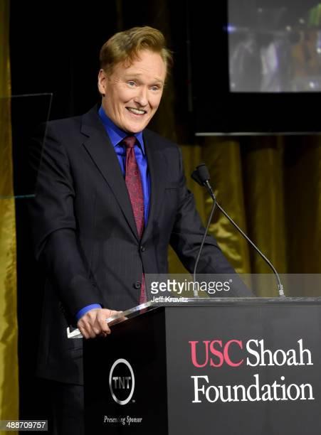 Host Conan O'Brien speaks onstage during USC Shoah Foundation's 20th Anniversary Gala at the Hyatt Regency Century Plaza on May 7, 2014 in Century...