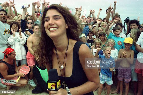 MTV host Daisy Fuentes gets the crowd going during the filming of Beach MTV at the Beachcomber in Wellfleet Massachusetts 29th July 1990