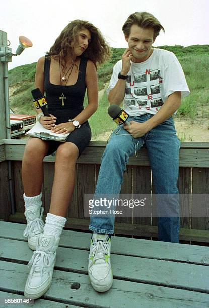 MTV host Daisy Fuentes with actor Christian Slater during the filming of Beach MTV at the Beachcomber in Wellfleet Massachusetts 29th July 1990