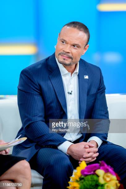 Host Dan Bongino as US Open winner Gary Woodland visits FOX Friends at Fox News Channel Studios on June 18 2019 in New York City