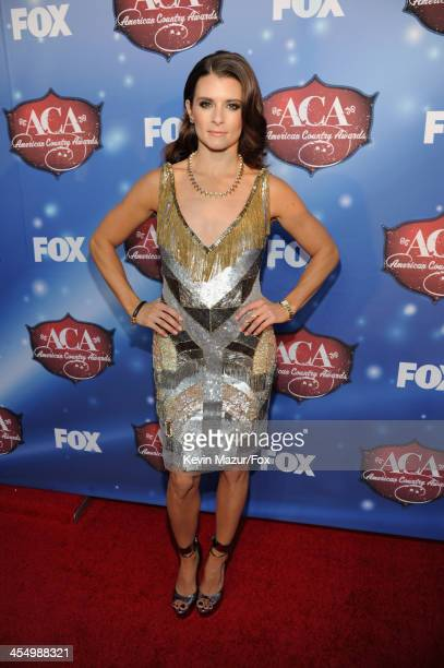 Host Danica Patrick arrives at the American Country Awards 2013 at the Mandalay Bay Events Center on December 10, 2013 in Las Vegas, Nevada.