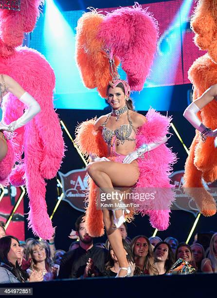Host Danica Patrick performs onstage during the American Country Awards 2013 at the Mandalay Bay Events Center on December 10 2013 in Las Vegas Nevada