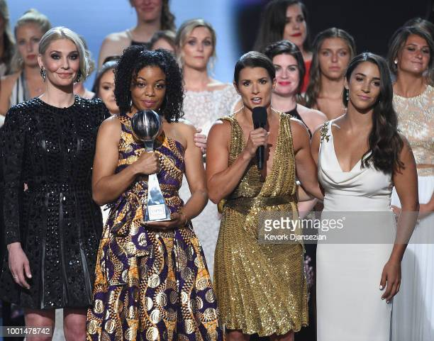 Host Danica Patrick Sarah Klein Tiffany Thomas Lopez Aly Raisman and recipients of the Arthur Ashe Award for Courage speak onstage at The 2018 ESPYS...