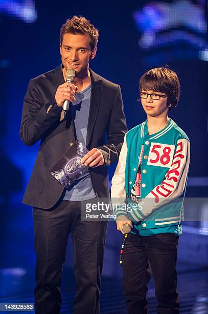 Host Daniel Assmann on stage with Tenyearold Samuel during DSDS Kids 1st Show at Coloneum on May 05 2012 in Cologne Germany