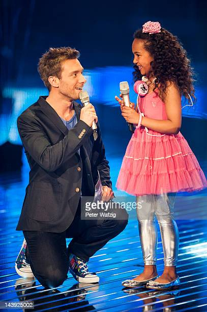 Host Daniel Assmann talks to Eightyearold Alysha during DSDS Kids 1st Show at Coloneum on May 05 2012 in Cologne Germany