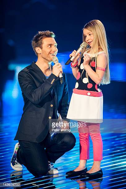 Host Daniel Assmann talks to Nineyearold Skyla during DSDS Kids 1st Show at Coloneum on May 05 2012 in Cologne Germany