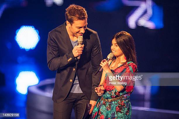Host Daniel Assmann talks to Tenyearold Erisa during DSDS Kids 1st Show at Coloneum on May 05 2012 in Cologne Germany