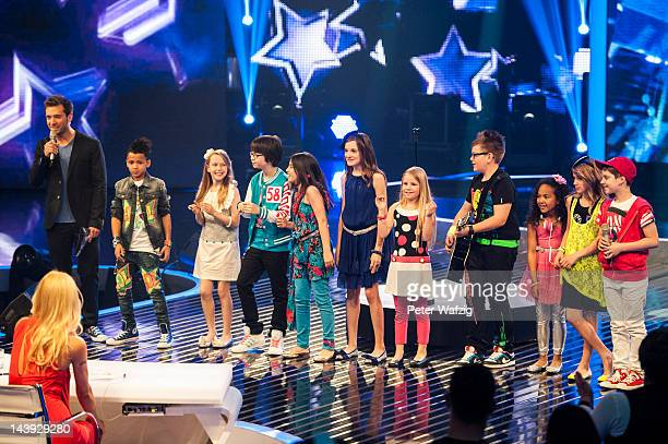 Host Daniel Assmann together with the kids talks to the jury during DSDS Kids 1st Show at Coloneum on May 05 2012 in Cologne Germany