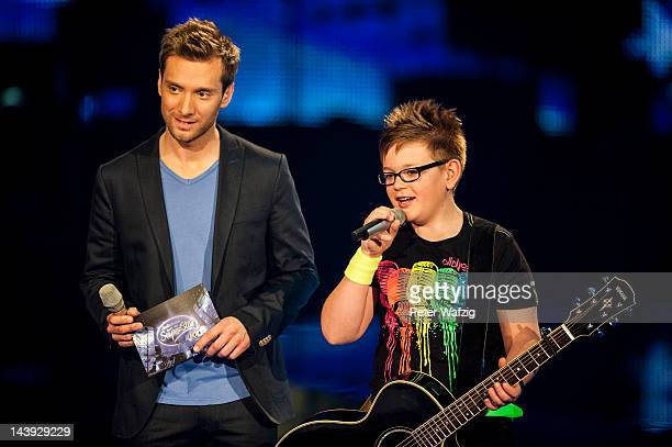 Host Daniel Assmann together with Thirteenyearold Julius during DSDS Kids 1st Show at Coloneum on May 05 2012 in Cologne Germany