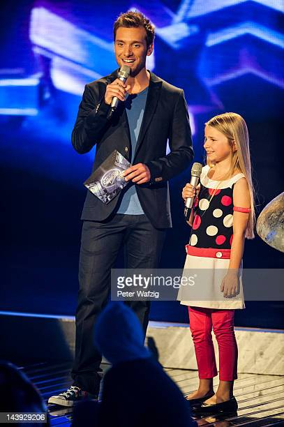 Host Daniel Assmann with Nineyearold Skyla during DSDS Kids 1st Show at Coloneum on May 05 2012 in Cologne Germany
