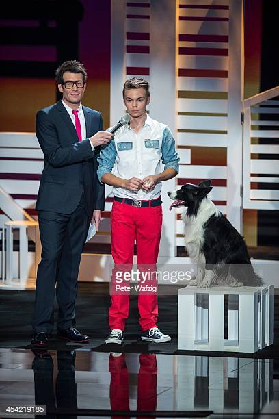 Host Daniel Hartwich and Lukas Pratschker with his dog Falco talk during the second Semifinal of 'Das Supertalent' TV Show on December 07 2013 in...