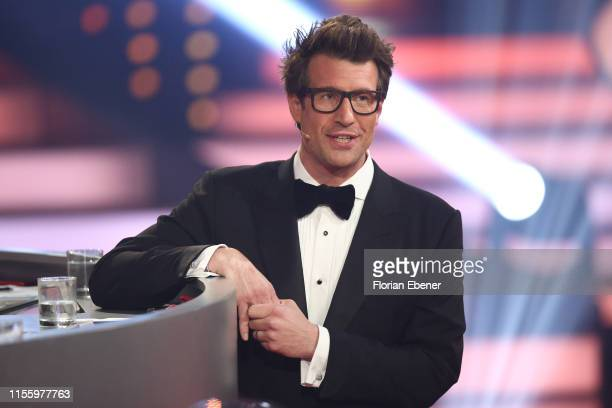 Host Daniel Hartwich is seen on stage during the finals of the 12th season of the television competition Let's Dance on June 14 2019 in Cologne...