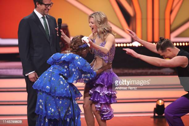 Host Daniel Hartwich juror Motsi Mabuse Ella Endlich and Valentin Lusin speak on stage during the 5th show of the 12th season of the television...